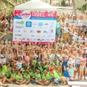 100 girls together in the water for the Butterfly Effect event Cabarete